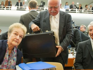 Peter Gauweiler (C) of the German Christian Social Union joins fellow petitioner of the ESM, Herta Daeubler-Gmelin (L) and lawyer Dietrich Murswiek (R)  inside the courtroom of the Federal Constitutional Court in Karlsruhe, southwestern Germany, on September 12, 2012 prior to the final ruling on the European Stability Mechanism (ESM) bailout fund.
