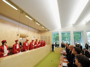 Judges of Germany's Constitutional Court prepare to leave the court room after they have given the verdict on Germany's ratification of the European Stability Mechanism (ESM) and fiscal compact on September 12, 2012 in Karlsruhe, Germany.