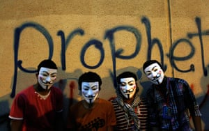 Benghazi protest: Egyptian protesters wearing Guy Fawkes masks pose