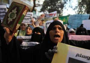 Benghazi protest: An Egyptian protester holds a copy of the holy Qu'ran