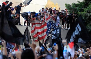 Benghazi protest: Protesters destroy an American flag from the US embassy in Cairo