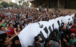 Benghazi protest: Egyptian protesters holds a giant banner reading 'the Prophet' in Arabic