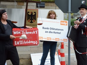 A group of political activists demonstrate in front of the main gate of Germany's Constitutional Court against the verdict on Germany's ratification of the European Stability Mechanism (ESM) and fiscal compact on September 12, 2012 in Karlsruhe, Germany.