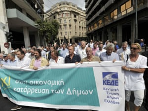 Greek municipal workers and local mayors march on September 12, 2012 in the center of Athens.