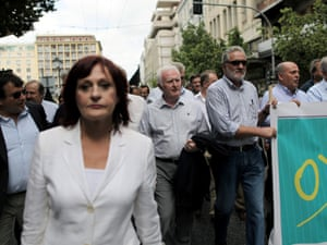 """Mayors carry a banner which reads """"No"""" during an anti-austerity protest by local authority workers, in central Athens, on Wednesday, Sept. 12, 2012."""