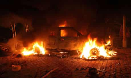 A vehicle in flames inside the US consulate compound in Benghazi, Libya