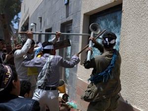Yemeni protesters smash windows of the US embassy in Sana'a.  The security forces responded with heavy fire.