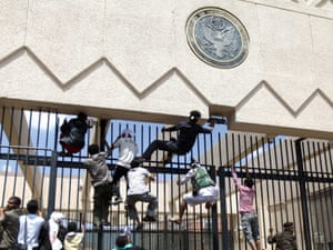 Protesters climb a fence at the US embassy in Sana'a September. Yemen's embassy in Washington said no casualties were reported.