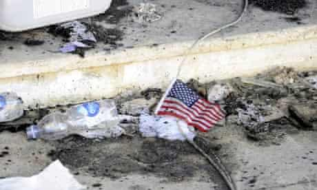 A US flag lies amid the rubble at the US consulate in Benghazi, Libya,where Chris Stevens was killed
