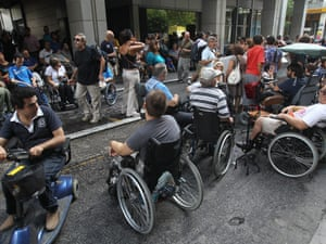 Blind and disabled people block the entrance of the Finance Ministry in Athens protesting against austerity measures. Photograph:  EPA/Orestis Panagiotou