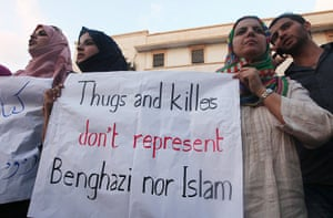 Libya protests: Demonstrator hold a placard during a rally to condemn the attack