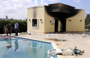 Libya protests: People inspeact damage in the grounds of the gutted US embassy in Benghazi