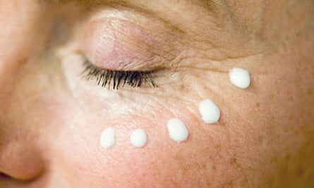 Splodges of anti-ageing cream around a woman's eye
