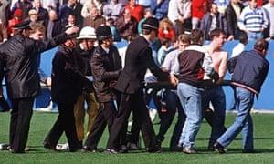 Policemen rescue soccer fans at Hillsborough