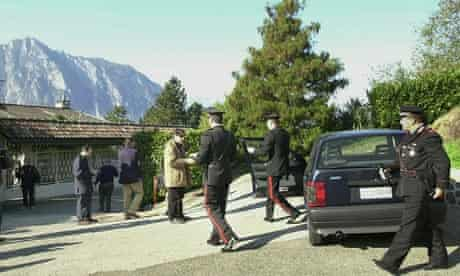 Italian Carabinieri and journalists outside the villa of Nada Management