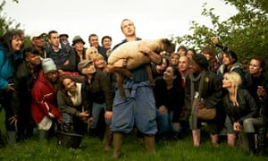 Farmer Wainwright and followers in The Audience