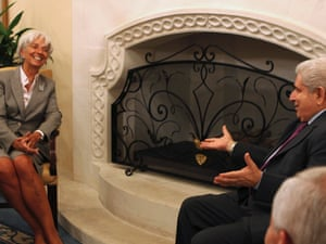 IMF Managing Director Christine Lagarde (L) speaks with Cypriot President Demetris Christofias during their meeting in Cyprus September 13, 2012.
