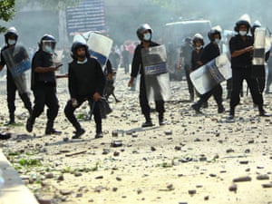 Protesters clash with riot police who fired teargas and rubber bullets at them near the US embassy in Cairo on Thursday.