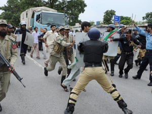 Pakistani soldiers hold back Muslim protesters shouting anti-US slogans as they attempt to reach the US embassy during a demonstration against the anti-Islam film in Islamabad.