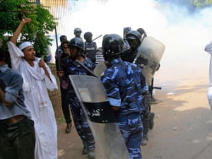 Sudanese policemen try to disperse protesters demonstrating against an amateur film mocking Islam outside the German embassy in Khartoum.