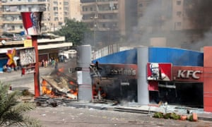A Hardee's and a Kentucky Fried Chicken (KFC) fast food outlet burns after protesters set the building on fire in Tripoli, northern Lebanon September 14, 2012. Hundreds of protesters set alight a Kentucky Fried Chicken and a Hardee's restaurant in the northern Lebanese city of Tripoli on Friday, witnesses said, chanting against the pope's visit to Lebanon and shouting anti-U.S. slogans.      REUTERS/Omar Ibrahim (LEBANON - Tags: FOOD CIVIL UNREST) :rel:d:bm:GF2E89E0ZET01