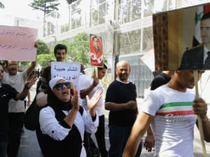 Pro-government supporters in Syria hold portraits of President Bashar al-Assad during a demonstration against a film mocking Islam outside the US embassy in Damascus on 14 September  2012.