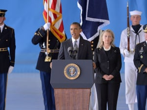 US President Barack Obama (C) speaks as Secretary of State Hillary Clinton looks on during the transfer of remains ceremony marking the return to the US of the remains of the four Americans killed in an attack this week in Benghazi, Libya, at the Andrews Air Force Base in Maryland on September 14, 2012.