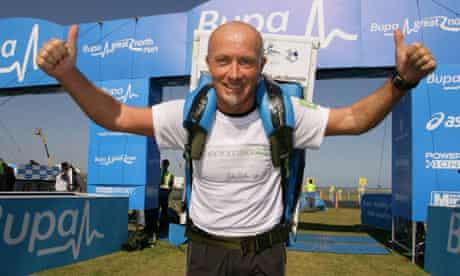 Tony Phoenix-Morrison runs with fridge on back