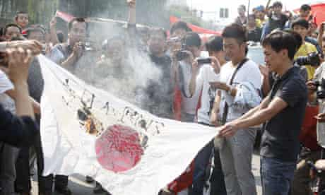 Chinese protesters burn a Japanese flag in Henan province