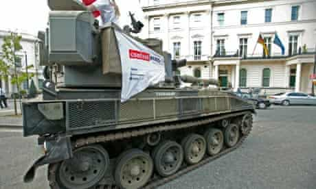anti-arms trade protestors rive a tank past the German embassy in London