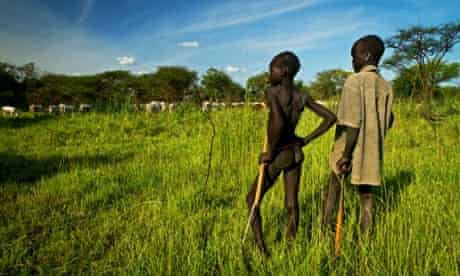 Boys from the Mundari tribe watch over their cattle in Terekeka, a community north of Juba in South Sudan. The Mandari are known for fishing with only spears and nets and for their cattle keeping traditions.