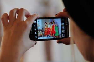 London Fashion day 5: A visitor photographs models during the Tata Naka