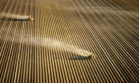Tractors ploughing vast field