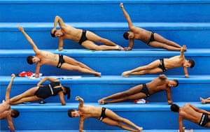 24 hours in pictures: Water polo players warm up before their training