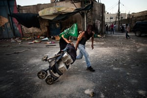 24 hours in pictures: Palestinians collect bricks in a pram against Israeli security forces