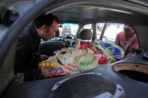 24 hours in pictures: Hindu devotees load an idol of elephant-headed Hindu God Ganesha into a car