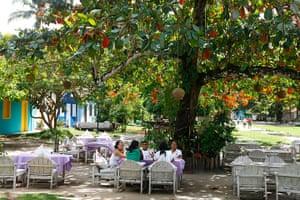 Brazil beaches: People sitting in a restaurant at Quadrado, Trancoso, Bahia.
