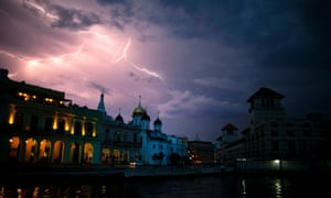 A flash of lightning illuminates the sky over the Malecon during a lightning storm in Havana, Cuba.