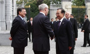 Chinese premier Wen Jiabao shakes hands with European Council President Herman Van Rompuy, and European Commission president Jose Manuel Barroso, looks on, as officials arrive for the EU-China summit in Brussels this morning.