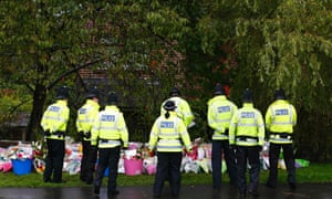 Floral tributes continue to be laid close to the scene where two police officers were killed in Hattersley near Manchester.