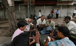 Indian laborers play a game of cards at a closed market area during a nationwide strike in New Delhi. Angry opposition supporters disrupted trains in India but had only limited success in enforcing a national strike to protest a government decision to cut fuel subsidies and open the country's huge retail market to foreign companies.