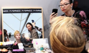 A model prepares backstage ahead of the Max Mara Spring/Summer 2013 fashion show as part of Milan Fashion Week