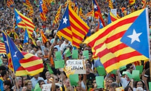 Marchers wave Catalonian flags in Barcelona this month, calling for independence from Madrid.