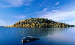 Island, Lake Inari, Lapland, Finland.