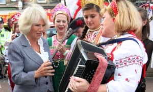 Camilla chats to musicians due to perform in Sunday's West Croydon Carnival of Cultures. Prince Charles and Camilla met local residents in Croydon a year on from the riots which took place the vicinity.