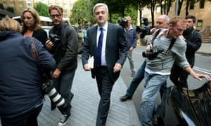 Former British energy minister Chris Huhne is surrounded by press photographers as he leaves Southwark Crown Court. Huhne was is court for a hearing where he is accused of perverting the course of justice over allegations that he dodged a speeding penalty.