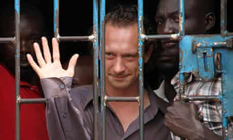 David Cecil in a court cell in Kampala