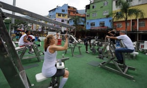 Residents enjoy a new open air gym at the main entrance of the Rocinha favela in Rio je Janeiro. The government announced the launch of the Pacifier Police Unit to bring stability the favelas by nearly doubling the police presence.
