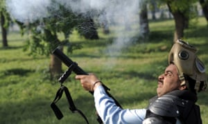 A Pakistani riot police fire tear-gas shells during a protest against an anti-Islam film in Islamabad.