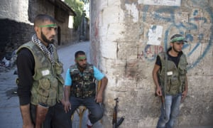 Syrian rebel fighters keep their position at a checkpoint in the Old City of Aleppo. More than 29,000 people have been killed in violence in Syria since an anti-government uprising broke out in March last year.